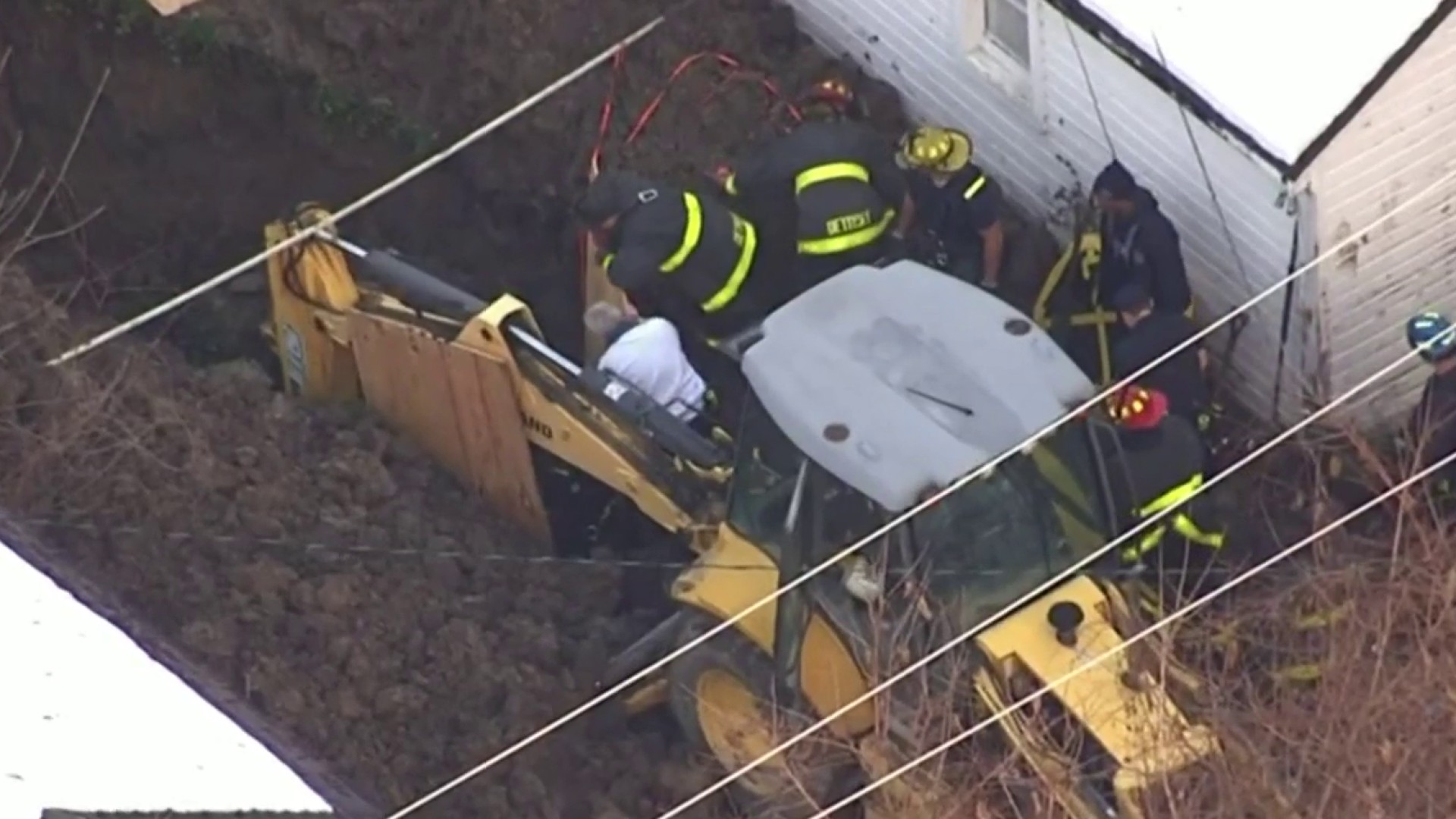 Crews work to rescue man trapped in trench in backyard of Detroit home - WDIV ClickOnDetroit
